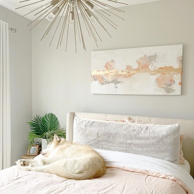 midcentury modern bedroom lighting idea with sputnik chandelier above bed