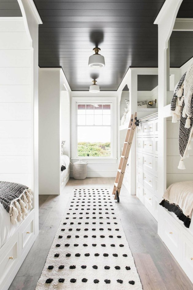 white and black bedroom with bunk beds