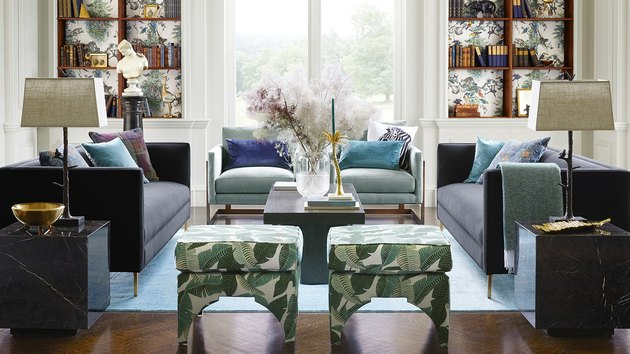 light and dark living room with accent botanical ottomans