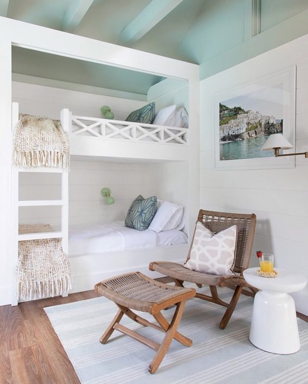 beach chic bedroom with white bunk beds and ceiling beams