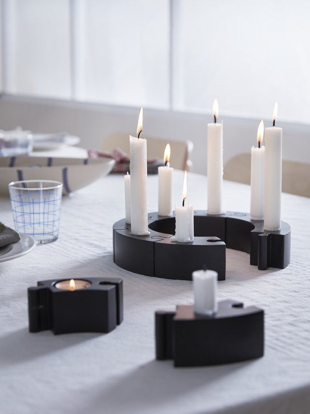 candlesticks in black holders