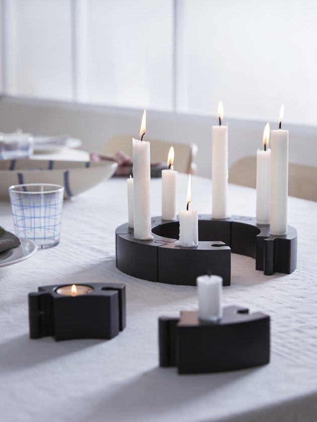 candlesticks in black holders