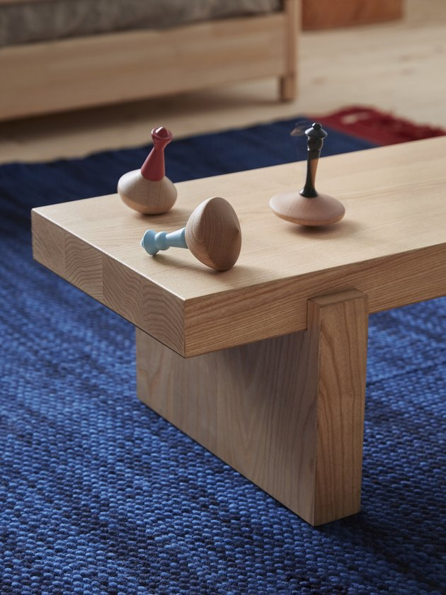 wood bench with game pieces on top