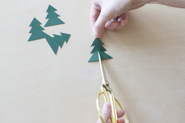 Cutting vertical slit in paper Christmas tree