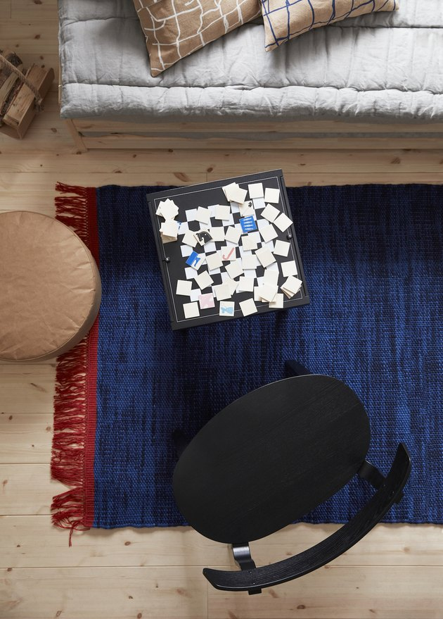 overhead view of black table with game and black chair