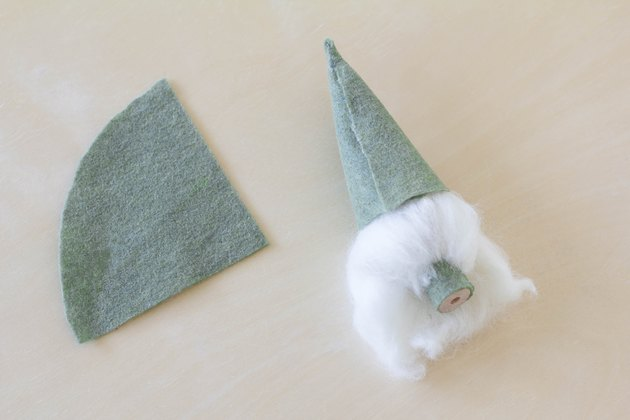 Gluing felt in cone shape on top of gnome's head