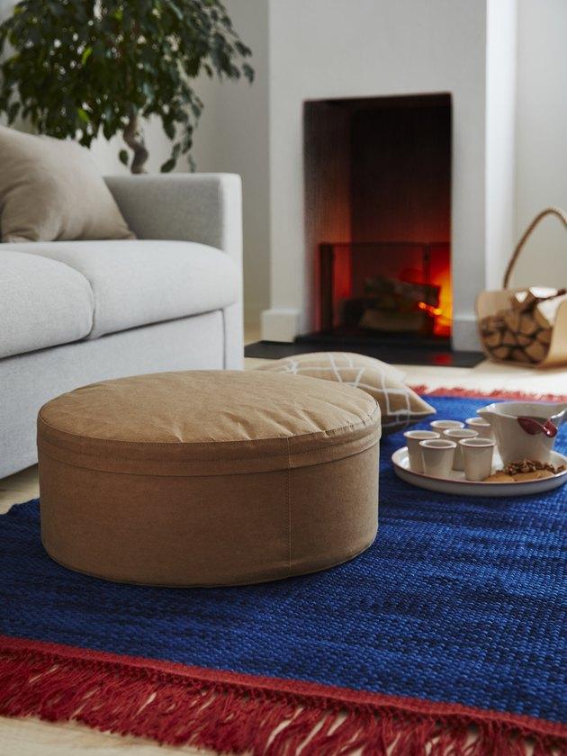 beige pouf near couch