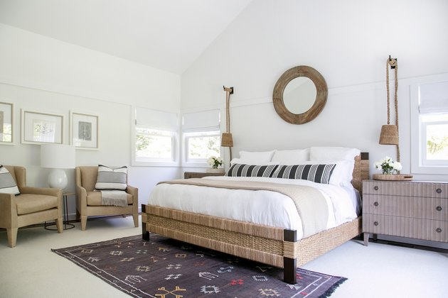 symmetrical bedroom with white walls and pendant lighting