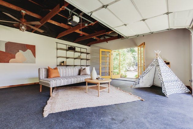 Small Garage Ideas with gray floor, art, striped sofa, and fort