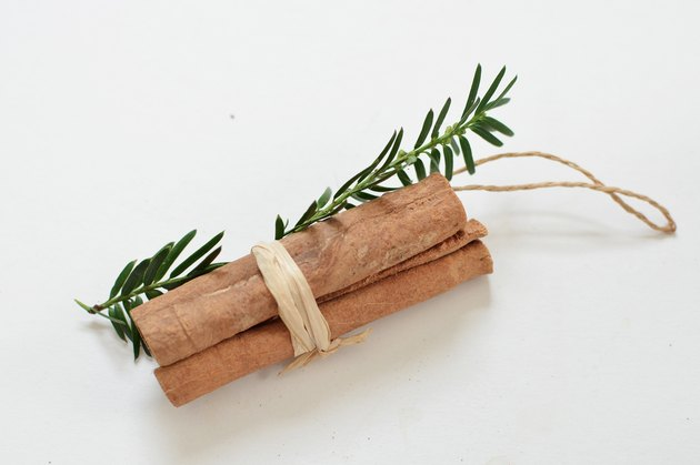 Cinnamon sticks and fresh rosemary ornament DIY.