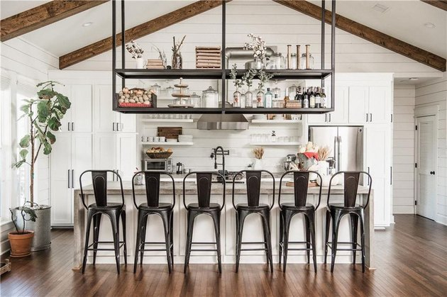 farmhouse kitchen with black chairs