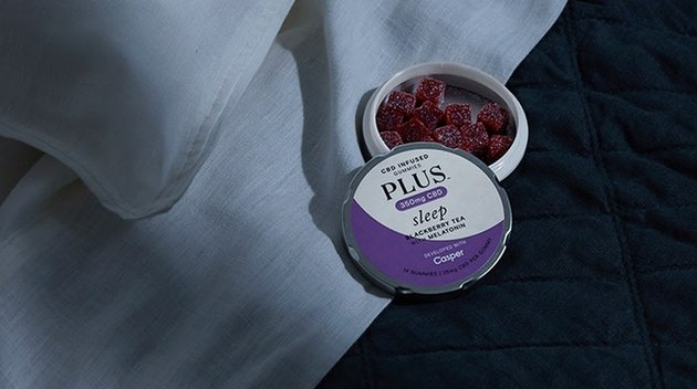pillows with tin of gummies nearby