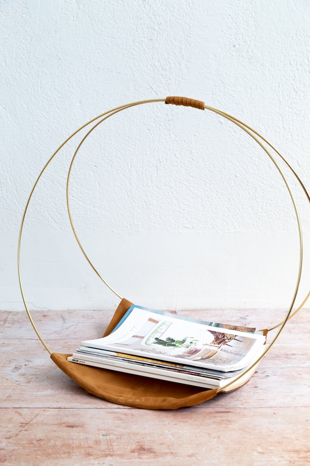 DIY Magazine Rack using gold macrame hoops and leather