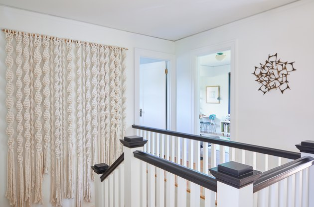 staircase with macrame wall hanging