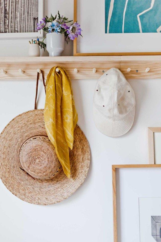 bedroom storage idea with shelf and peg rail