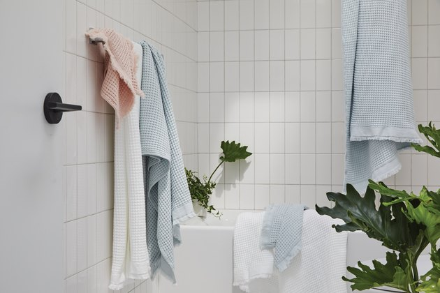 white bathroom with colorful towels