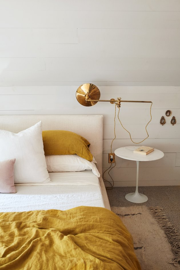 Brass wall-mounted light modern bedroom lighting idea