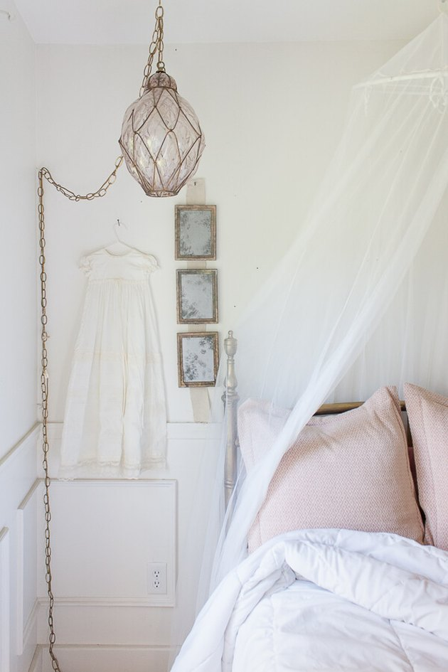 Vintage decor in French country bedroom with bed canopy and pendant light