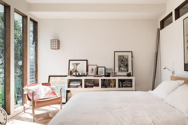 bedroom with bookcase and artwork