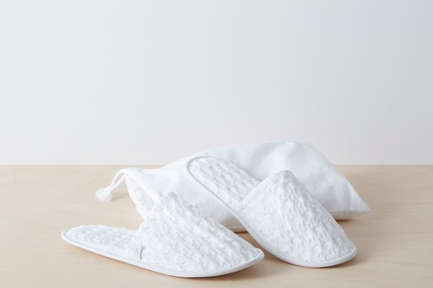 white textured slippers