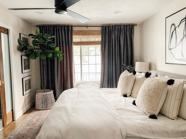 corner bedroom layout idea with fiddle leaf fig in neutral bedroom