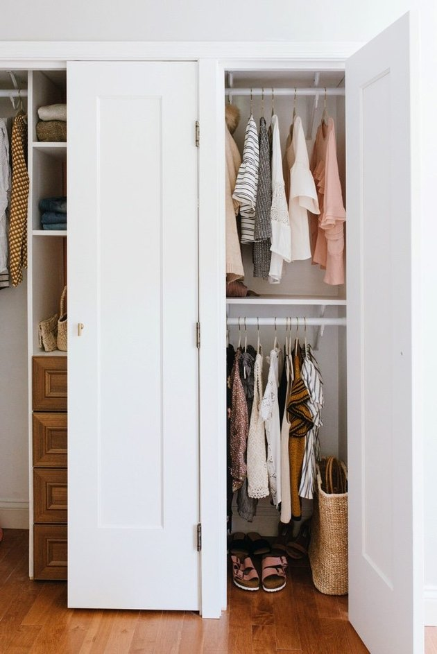 bedroom closet idea for small space with hanging clothes and drawers