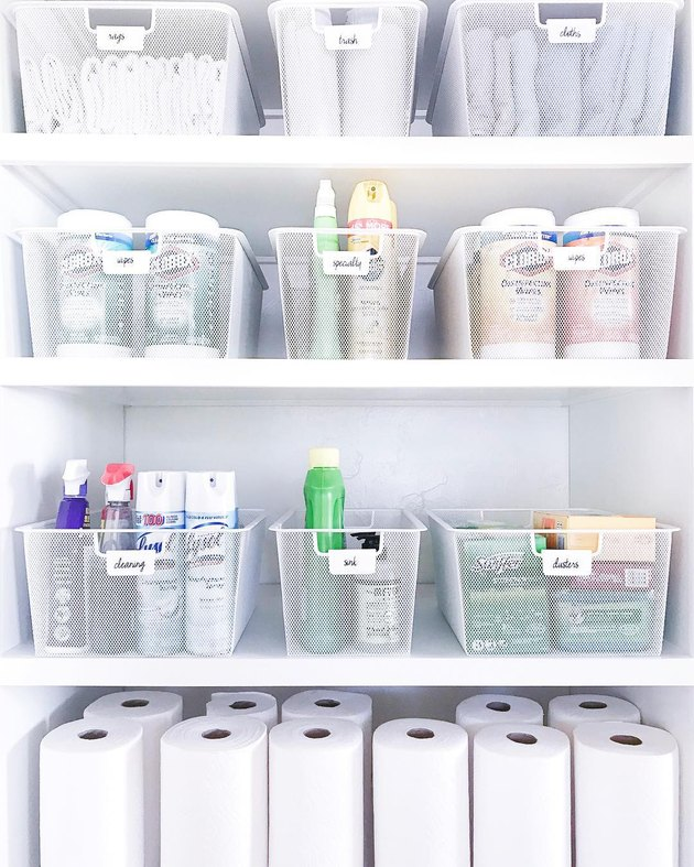 Cleaning Closet storage idea  full of supplies in wire baskets