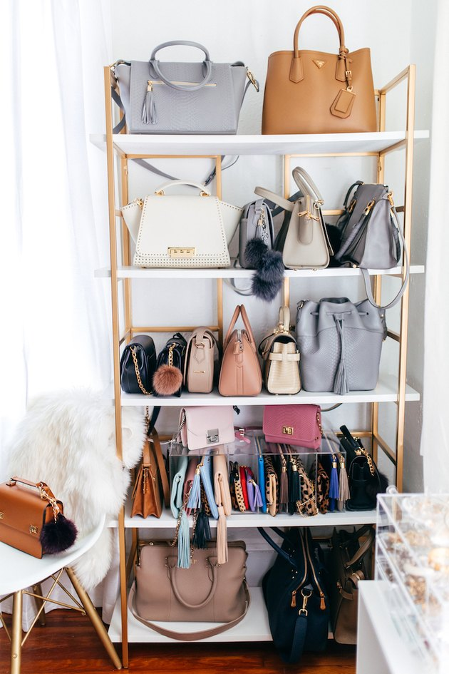 handbag storage on brass bookcase