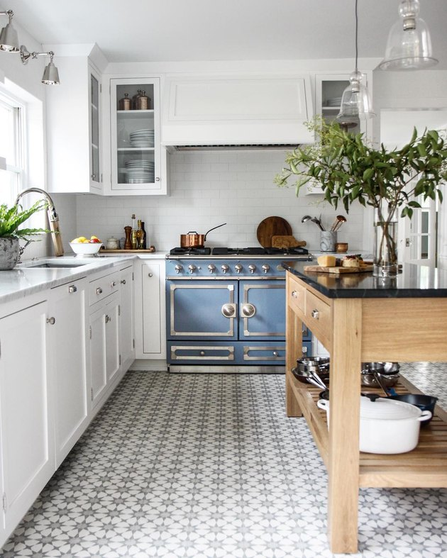 vintage kitchen appliances with patterned floor tile and white cabinets