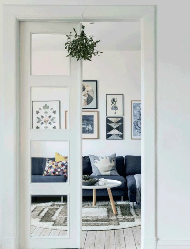 minimalistic white scandinavian interior with mistletoe