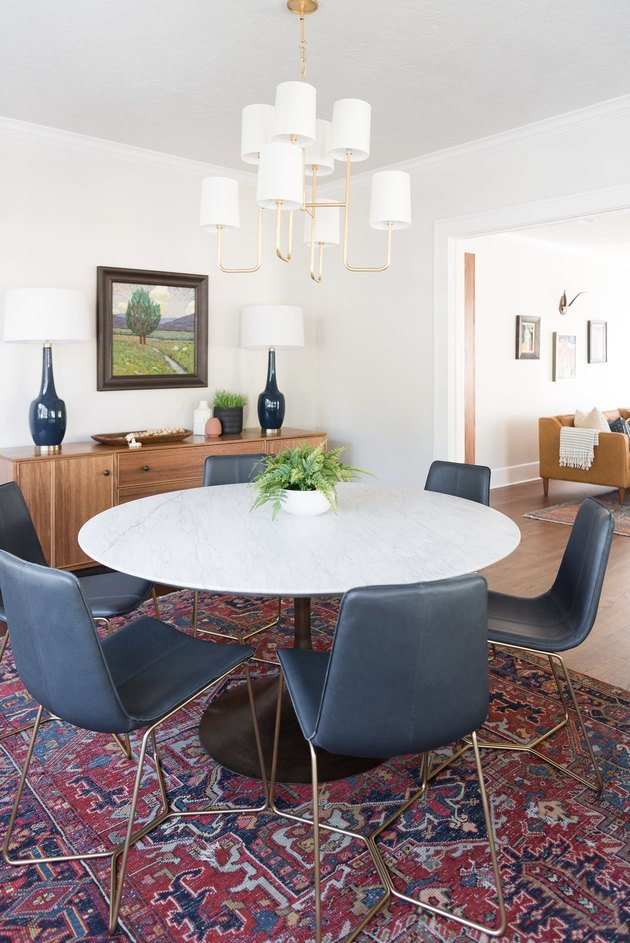 dining room space with blue chairs and chandelier