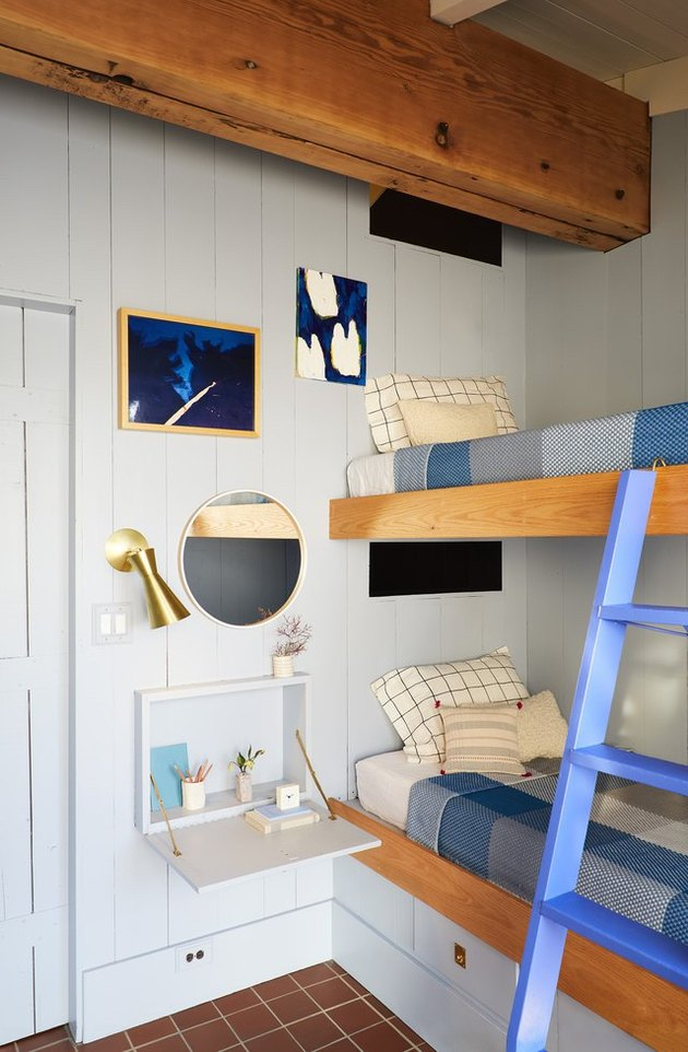whimsical farmhouse bedroom with bunk beds and shiplap walls