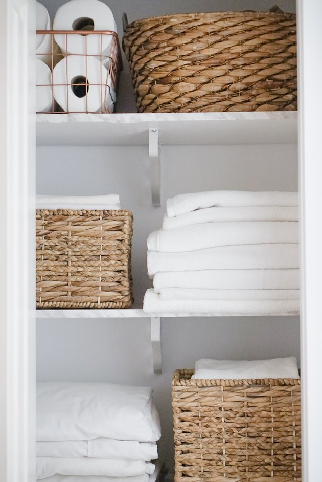 Linen Closet storage idea with neatly organized towels and woven bins