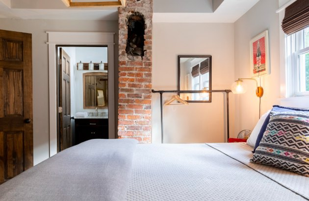 bedroom space with brick column in Craftsman home