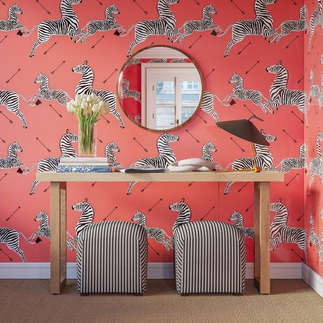 coral zebra wallpaper in entryway