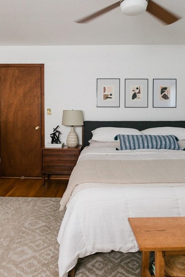 Midcentury modern bedroom style with low-height headboard and wood nightstands