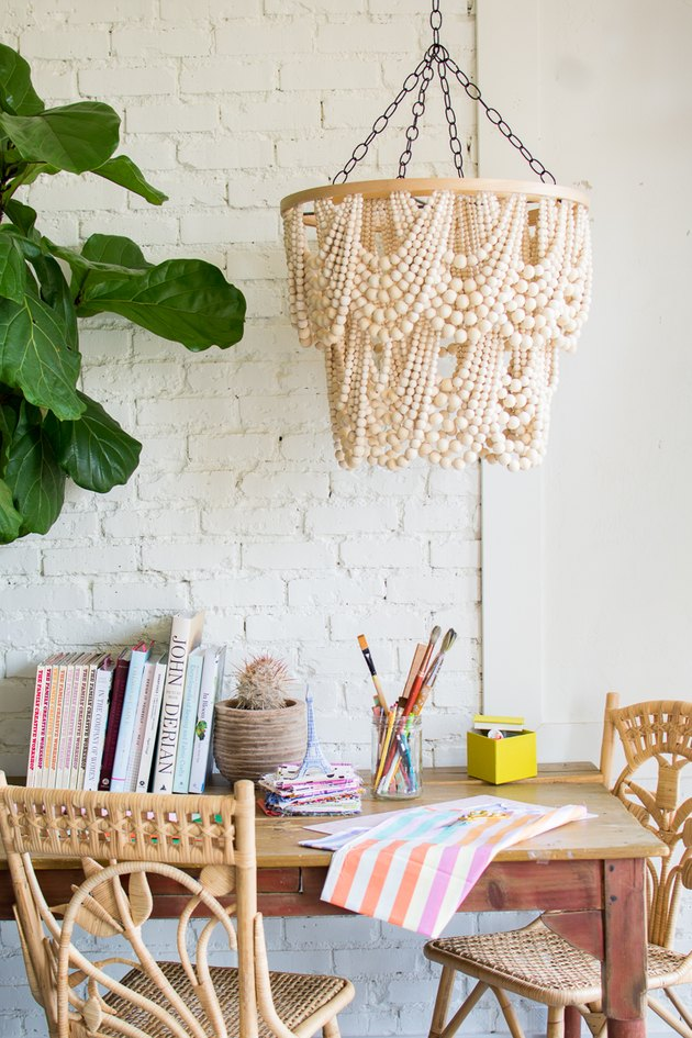 DIY beaded chandelier hanging above dining table