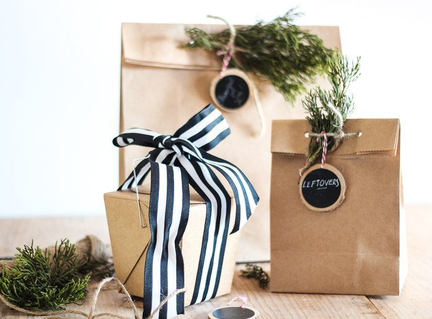 take out bags with labels and greenery for holiday leftovers