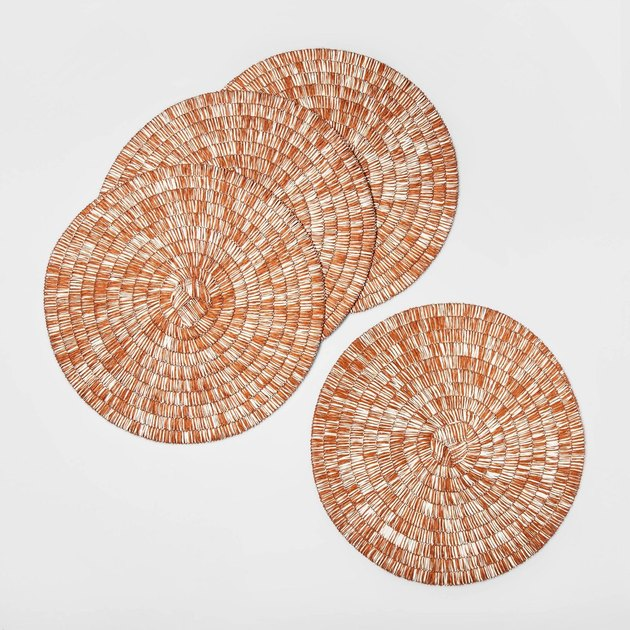 gold woven round placemats