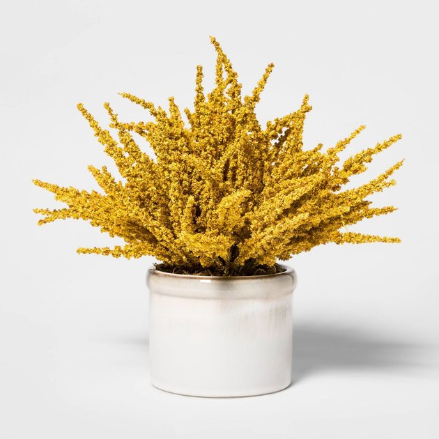 white ceramic pot with yellow artificial plant