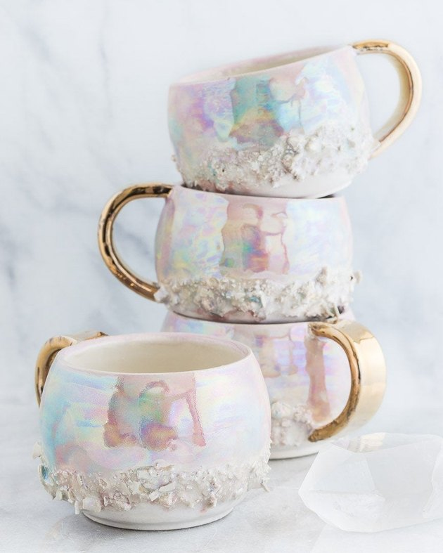 stacked iridescent mugs with gold handles