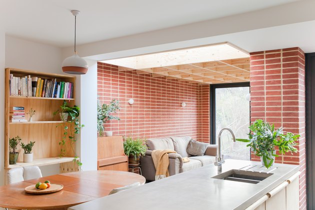 red brick wall in open concept floor plan