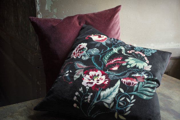 floral pillow and maroon pillow