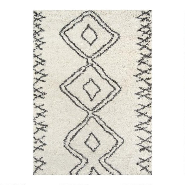 white and grey geometric area rug