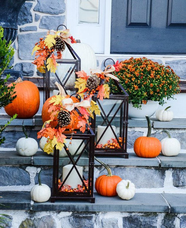fall-inspired candle lanterns lighting front porch