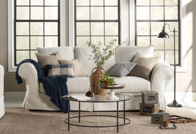 Birch Lane farmhouse furniture with slipcovered sofa and round coffee table