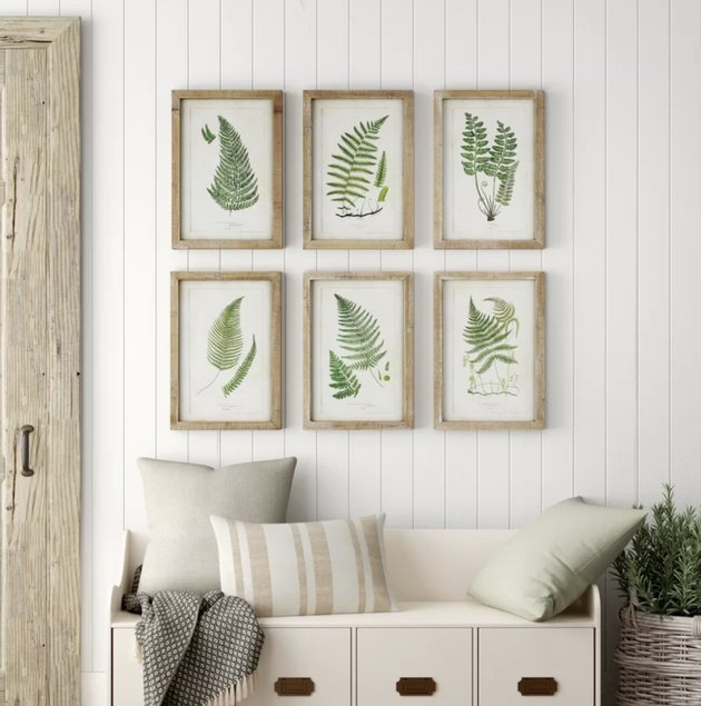 Birch Lane farmhouse decor in hallway with tongue and groove walls with botanical artwork