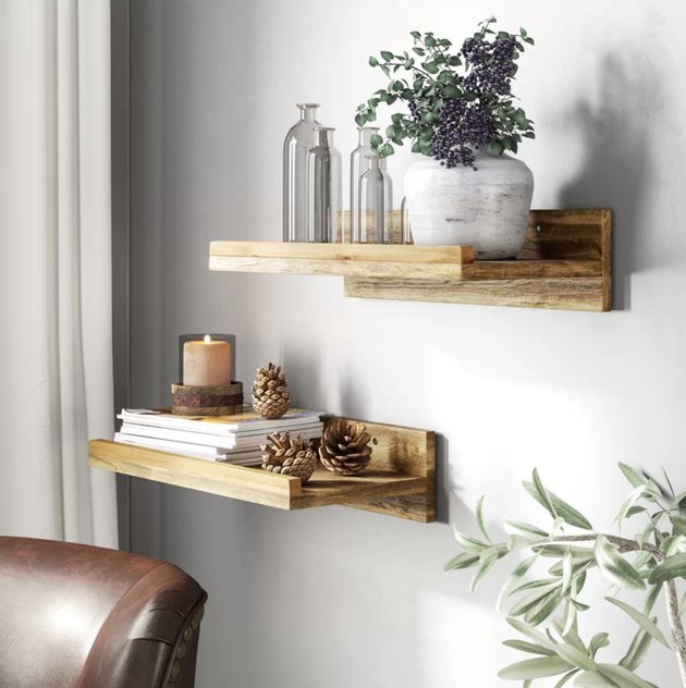 Wayfair farmhouse decor with wood floating shelves on the wall