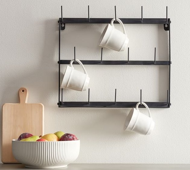 Pottery Barn farmhouse decor with iron mug rack and ceramic mugs