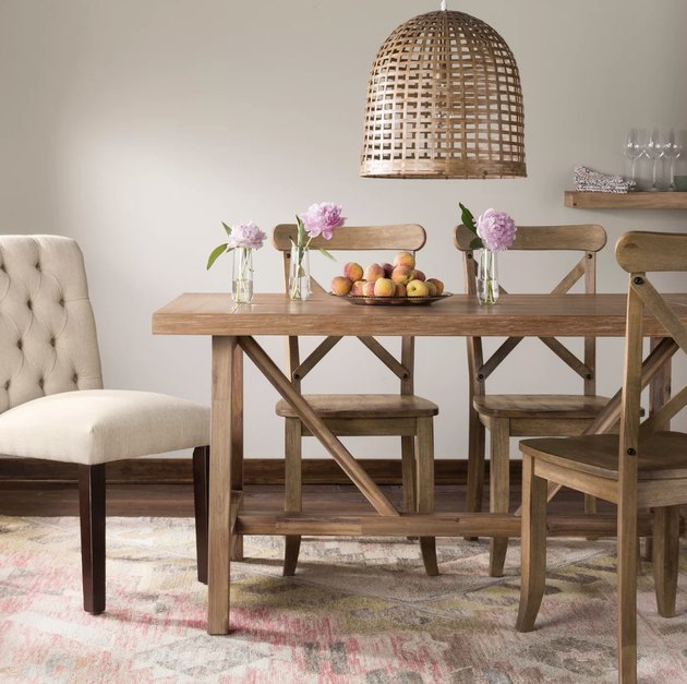 Target farmhouse furniture with rustic wooden dining table and chairs with woven pendant hanging above